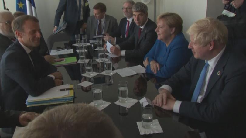 Президентът Еманюел Макрон, канцлерът Ангела Меркел и министър-председателят Борис Джонсън