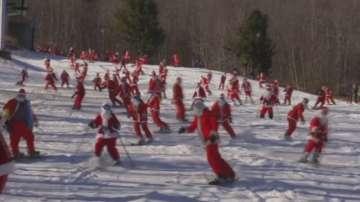 150 скиори и сноубордисти, преоблечени като Дядо Коледа се спускаха по пистите в