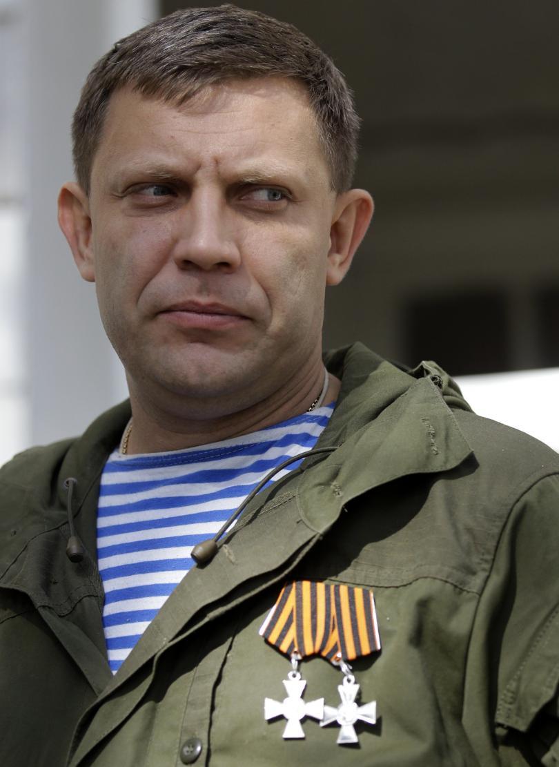 снимка 1 Около 100 000 души се прощават с лидера на проруските сепаратисти в Украйна