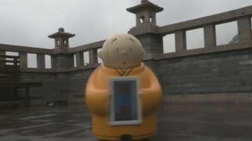 Робот предава тайните на будизма