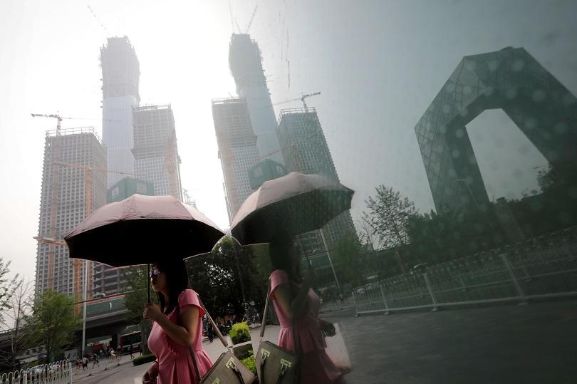 Десетки жертви на наводнения в Китай