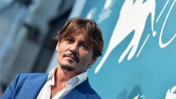 Джони Деп представи новия си филм на фестивала във Венеция
