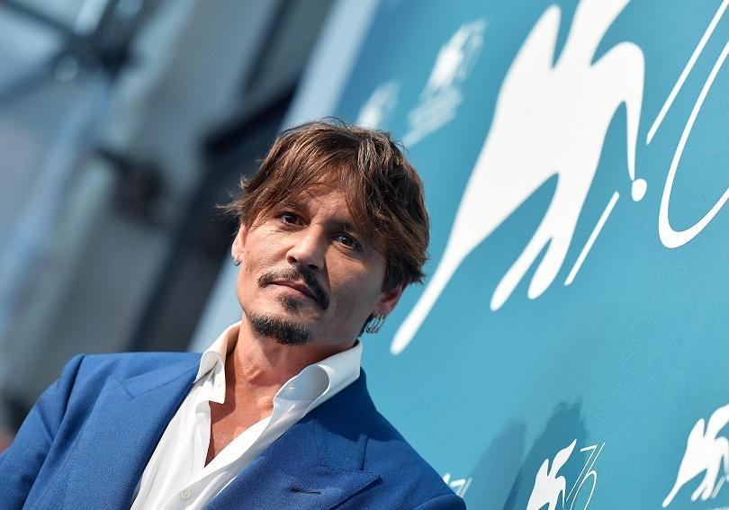 джони деп представи новия филм фестивала венеция