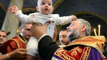 Хиляди деца получиха свето Кръщение в цяла България (СНИМКИ)