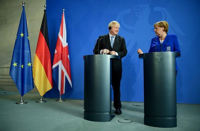 меркел обеща партньорство борис джонсън