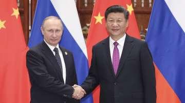 Владимир Путин подари на Си Цзинпин кутия руски сладолед