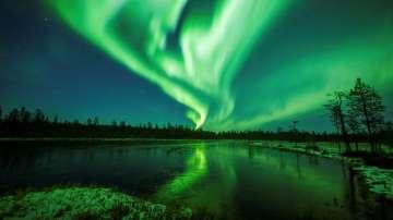 Северно сияние над Лапландия