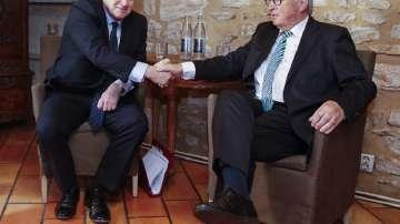 Юнкер и Джонсън обсъдиха Брекзит на охлюви и сьомга